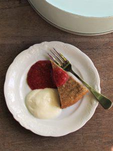 strawberry chia sauce on almond and quinoa cake